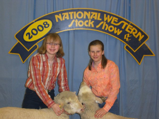 McCoy's Abbey, left, and Belle Horn show their Rambouillet sheep at the National Western Stock Show. Belle received eighth place and Abbey took ninth in the Junior Rambouillet Ewe Show. The girls were among a handful of Routt County area residents that took home awards from the recent show in Denver.