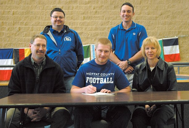 Moffat County High School football player J.T. Haddan, middle, is slated to sign a national letter of intent to play football at Colorado State University at Pueblo. He is joined by his father John, left, his mother Vicki, right, MCHS athletic director Jeff Simon, back left, and MCHS football coach Kip Hafey, back right.