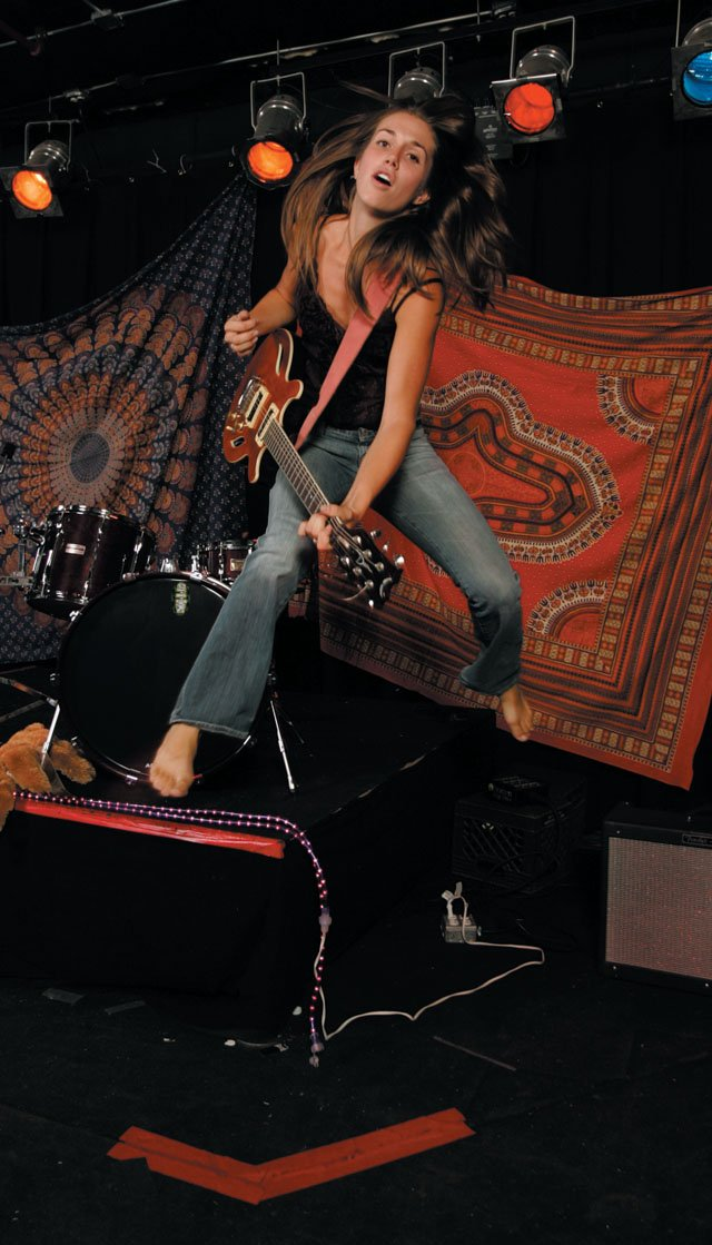 Tiffany Christopher Trio plays at 9:30 p.m. today at The Tap House. Pictured, front woman Christopher gets excited about playing guitar.