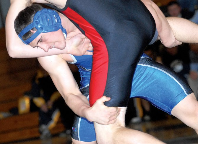 Moffat County's Lyle Shaffner slams Eagle Valley's John Crawford to the mat during Thursday's dual meet in Craig. The Bulldogs went 3-0 in its last regular season meet at home.