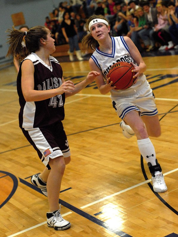 Moffat County's Angie Charchalis shoots during Friday night's game against visiting Palisade. Moffat County beat Palisade, 71-34. Charchalis led the Bulldogs in scoring with 24 points.