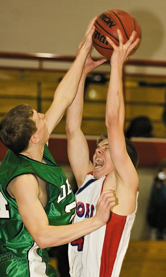 Steamboat Springs Connor Moore and Delta's Austin Watson battle for a rebound in the second half of Friday night's game at Steamboat Springs High School. Sailors won, 81-29.