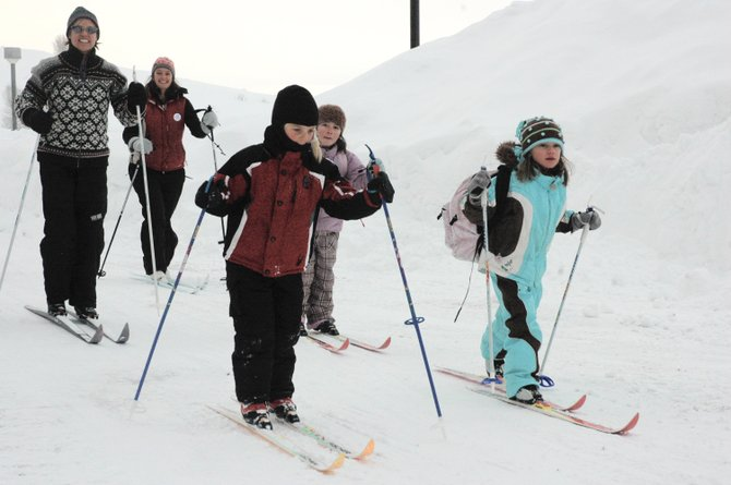 About 15 students cross-country skied to school along Butcherknife Trail on Thursday. The Ski to School program promotes healthy life habits of daily exercise.