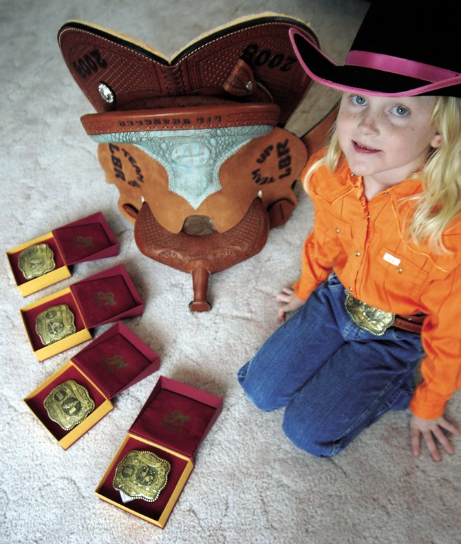 "Craig resident Jaidyn Steele proudly poses with her championship hardware. The 6-year-old was crowned ""Saddle Champ"" in her second year of competition."