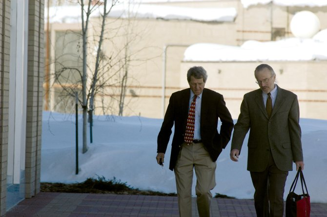 Routt County Sheriff Gary Wall, left, and his attorney, Ron Smith, walk from the Routt County Sheriff's Office to the Routt County Justice Center on Wednesday morning.