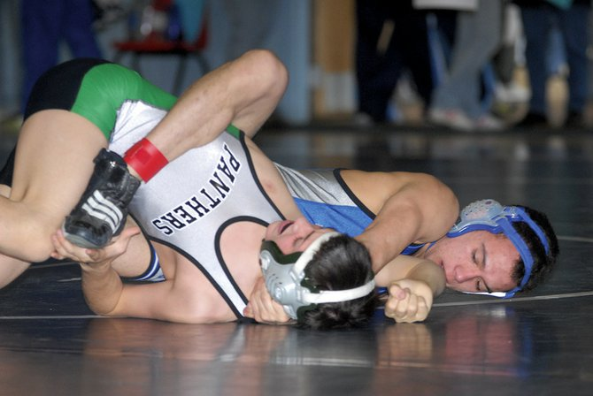 Moffat County High School's Cory Vigil pins Delta High School's Rudy Fantin at Friday's regional tournament at the high school. Competition continues today.