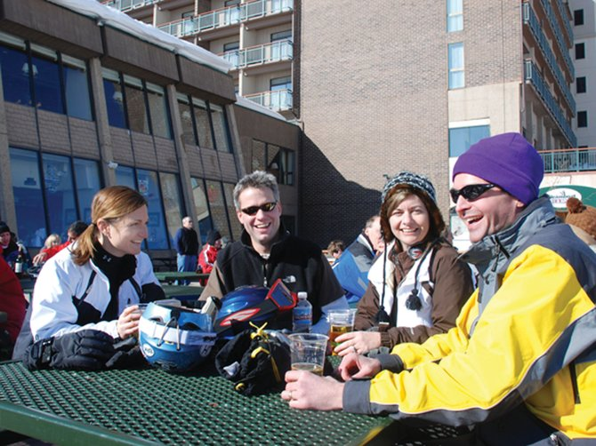 The Hammers and the Neus from Ottumwa and Carroll, Iowa, respectively, took advantage of one of the first sunny apres ski days of the season Friday outside Bear River Grill. Pictured are Darci Hammer, from left, Eric Neu, Lois Neu and Chuck Hammer.