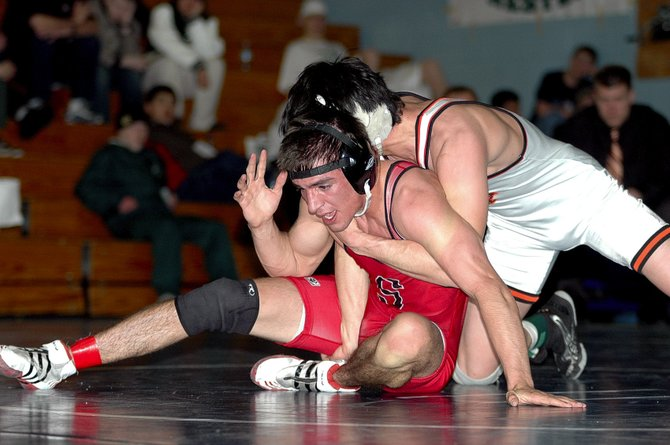 Houston Mader, bottom, wrestles with top-ranked 140-pounder Justin Samora from Montezuma-Cortez during regional competition Saturday at Moffat County High School. Samora defeated Mader, 4-2.