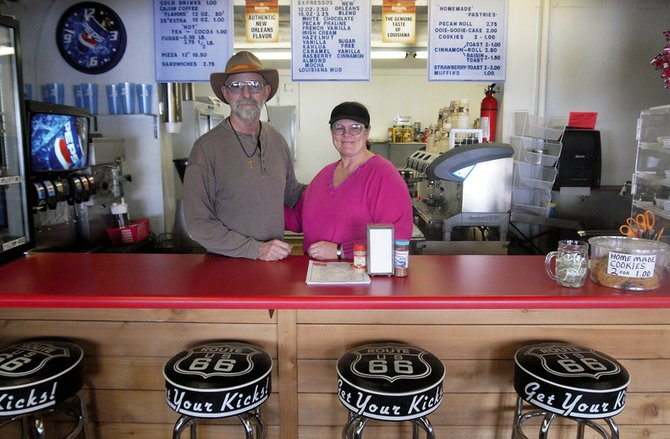 Joy, right, and Gabriel Daigle stand behind their counter at the Mom and Pop's Coffee Shop. They have owned 18 businesses since leaving their lives as Louisiana shrimpers and fishermen, including Wild West Barbeque and a mini-golf course in Craig.