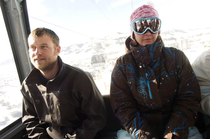 Cam Mayhue, left, and Heather White ride the gondola at Steamboat Ski Area on Wednesday afternoon.