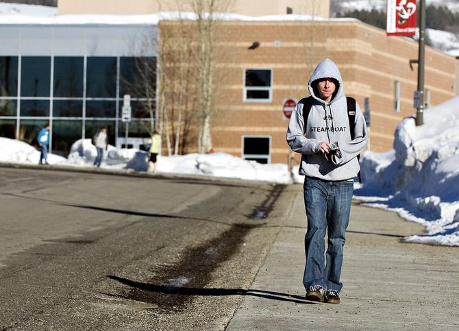 Steamboat Springs High School freshman Ben Massey leaves school after class Tuesday afternoon. The draft of the Steamboat Springs School District&#39;s 2008-09 calendar gives students Martin Luther King Jr. Day off and creates more five-day weeks.