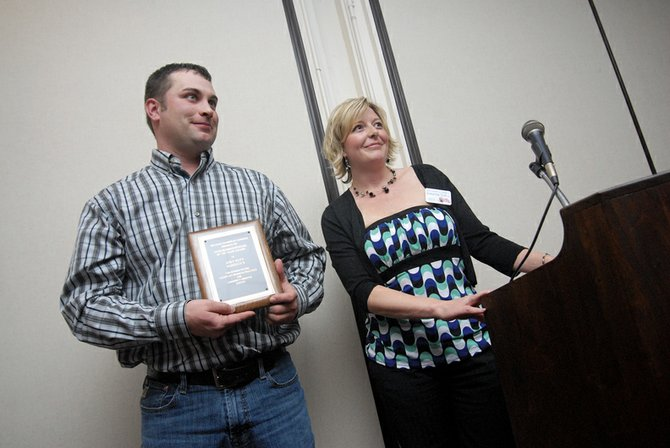 Andy Keith, of Murdoch's Ranch & Home Supply, accepts the Craig Chamber of Commerce's Businessperson of the Year award at the State of the County: An Inside Look at Moffat County from Chamber Director Christina Currie on Tuesday.