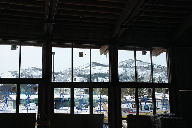 The acoustic glass in the new Strings in the Mountains pavilion frames the view of Emerald Mountain. This winter's heavy snow has set back construction, but music festival organizers are confident they'll make their late June opening.