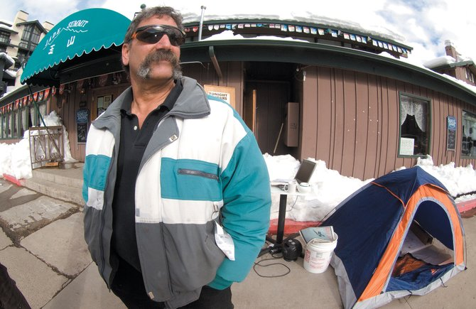 Steamboat Springs businessman Kevin Nerney stands outside Jade Summit and its upstairs bar, the Pirates Pub, which he runs with his wife, Kathy Nerney.  The city has prohibited Kevin Nerney from entering the establishment during business hours.