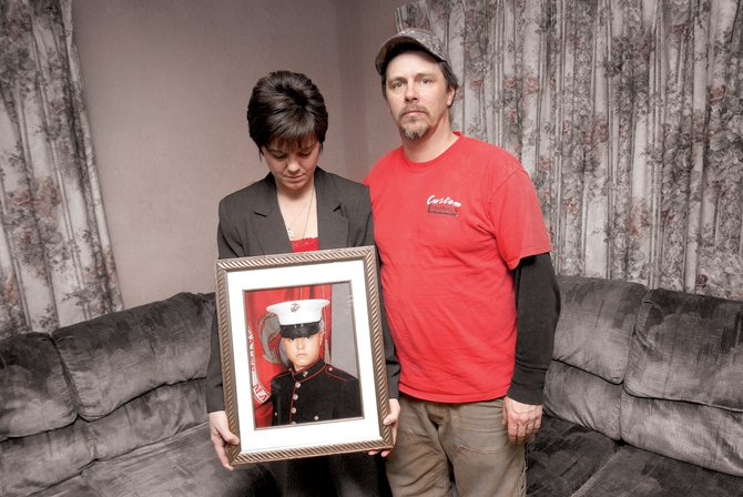 Sonja and Duane Laabs pose with a picture of their son, Wacie, in their Craig home Thursday night. Wacie, who is 19 and graduated from Moffat County High School in 2006, is scheduled to be deployed to Iraq on Monday.