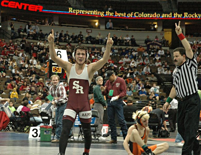 Soroco High School's Levi Gonzales celebrates his overtime victory Friday against Wiggins' Dillon McCombs in the Class 2A state wrestling championship 125-pound quarterfinals. The referee signals Gonzales' two winning takedown points.