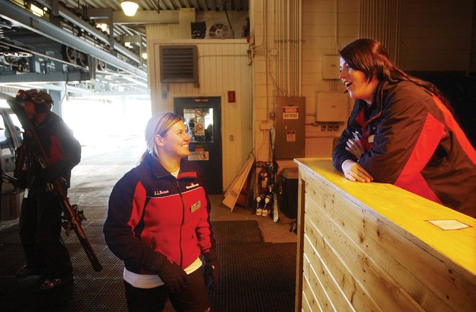 Australia natives Sarah Ford, left, and Lindsey Caddey chat during work Thursday in the Gondola Building at Steamboat Ski Area. The two are able to work in the United States using H-2B visas.