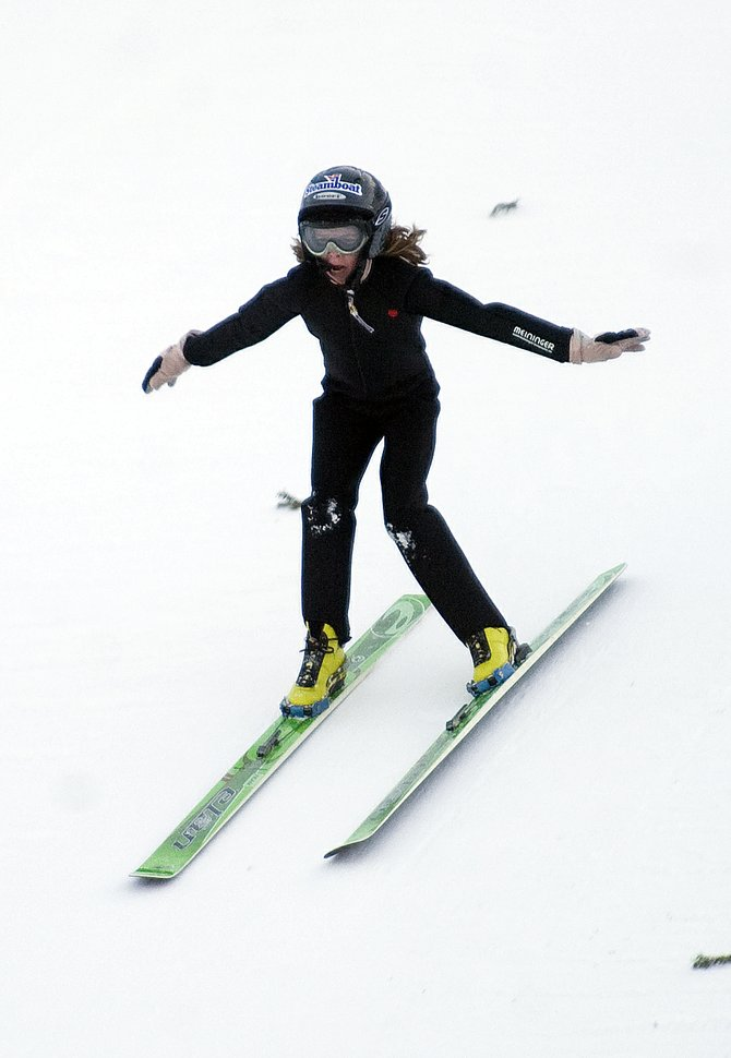 Kathleen O'Connell sticks her landing on Howelsen Hill in Steamboat Springs during ski jumping practice Wednesday afternoon. O'Connell has qualified for the upcoming Ski Jumping Nordic Combined Junior Olympics in Ishpeming, Mich.