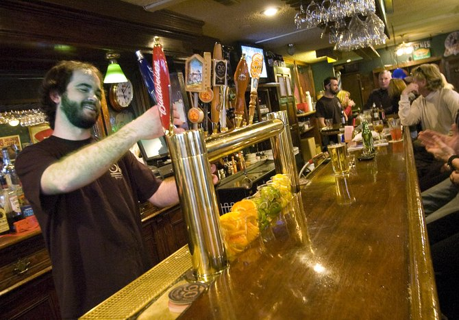 Bartender Sean Regan pours a beer at the Old Town Pub in Steamboat Springs on Friday afternoon.
