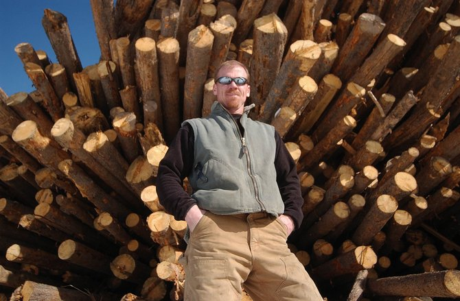 Confluence Energy co-owner Mark Mathis has been stockpiling lodgepole pines this winter at a piece of property in Kremmling, where he is building a wood pellet production facility. Mathis is hopeful the new plant will be turning the beetle-killed timber into pellets once it is finished in four weeks.
