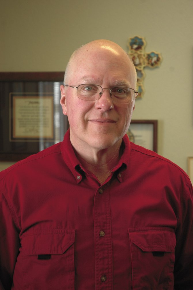 Dave McKnight, pastor at Concordia Lutheran Church, is the first chaplain for the Steamboat Springs Police Department.