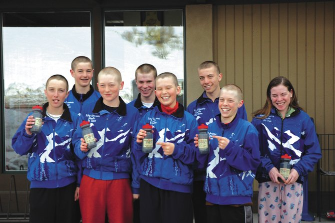 From left, Michael Ward, Aleck Gantick, Erik Lynch, Jake Barker, Austin Reed, Ben Berend, Cliff Field and Mary O'Connell stand outside of Mountain Cuts after getting their new hairdos. The eight members are off to J-2 Junior Olympics in Michigan on Monday.