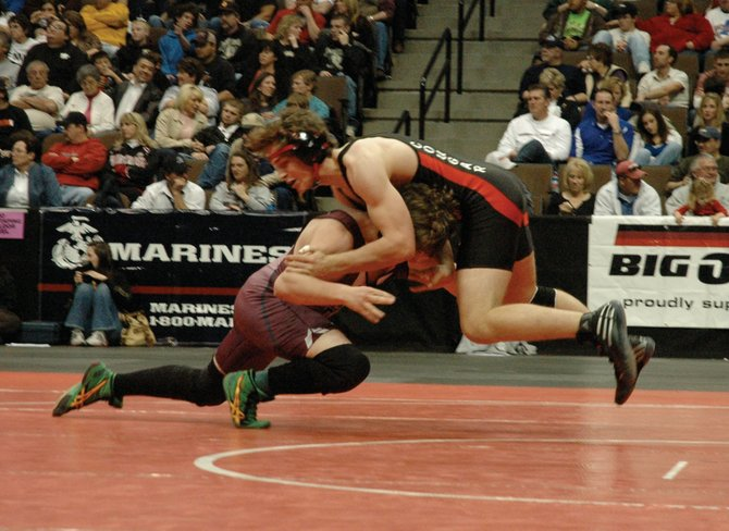 Soroco senior Dennis Morgan and Burlington's Mike Satterly battle in the 189-pound state wrestling championship final Saturday at the Pepsi Center in Denver. Satterly won 5-0.