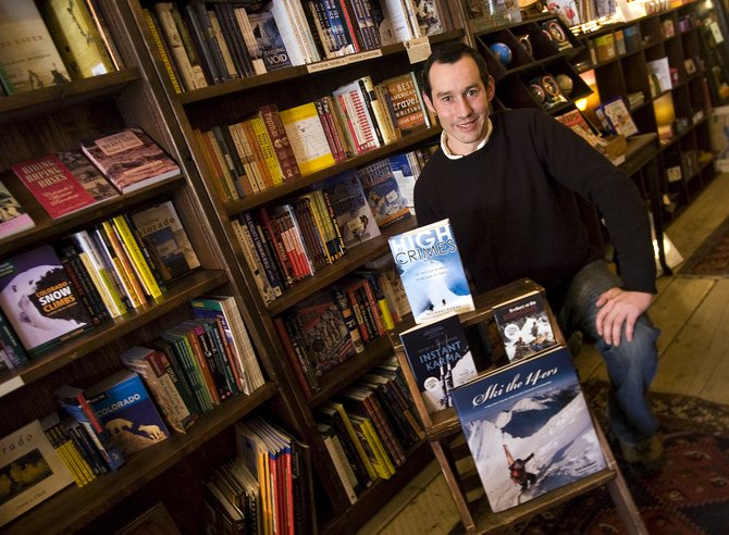Josh Karzen displays a selection of books included in the Epilogue Outdoor Author Series at Epilogue Bookstore in Steamboat Springs on Wednesday afternoon.