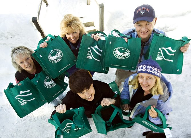 Local residents, clockwise from left, Sharon Glover, Sue Carter, Mike Zopf, Linda Lewis and Catherine Carson show off a collection of reusable shopping bags that will be sold for $1 each by Yampa Valley Recycles in an effort to reduce the use of disposable plastic bags in the local area.