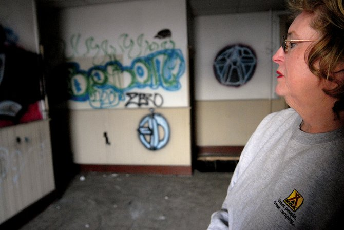 Patt McCaffrey stands inside the train depot in Craig, which recently was put on Colorado's Most Endangered Places list.  The depot, which was built in 1917 as the final stop for the Moffat rail line but hasn't been in use for 40 years, has been plagued with vandals in recent years.