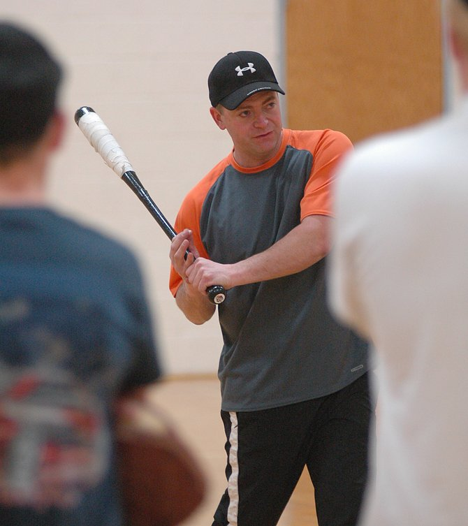 Hayden High School baseball coach Wayne DeLuca demonstrates hitting techniques to his team Friday. DeLuca and the Tigers will be taking the field this spring, the first Hayden High School baseball team to do so.