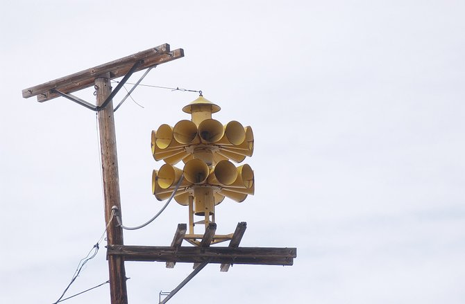 Perched on top of a wooden pole in the 800 block of Oak Street is a siren that sounds every day at noon.