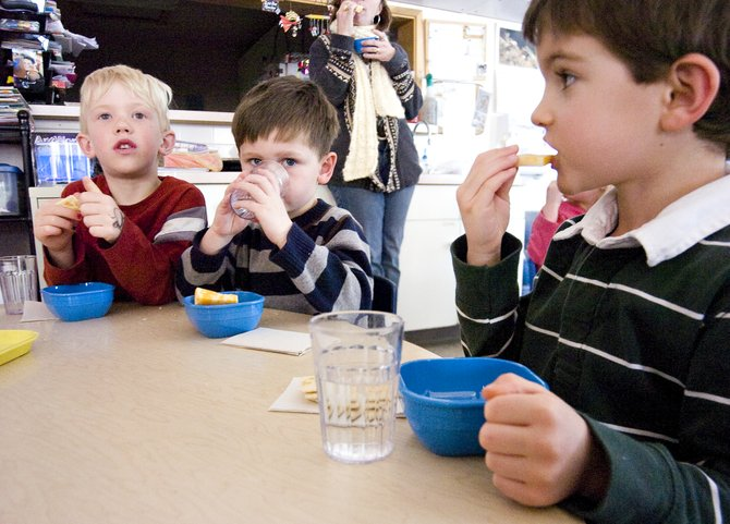 Pre-Kindergartners, from left, Daniel Kempers, Dallas Whitmore and Jack Cashen enjoy an afternoon snack at the Discovery Learning Center in Steamboat Springs on Monday.