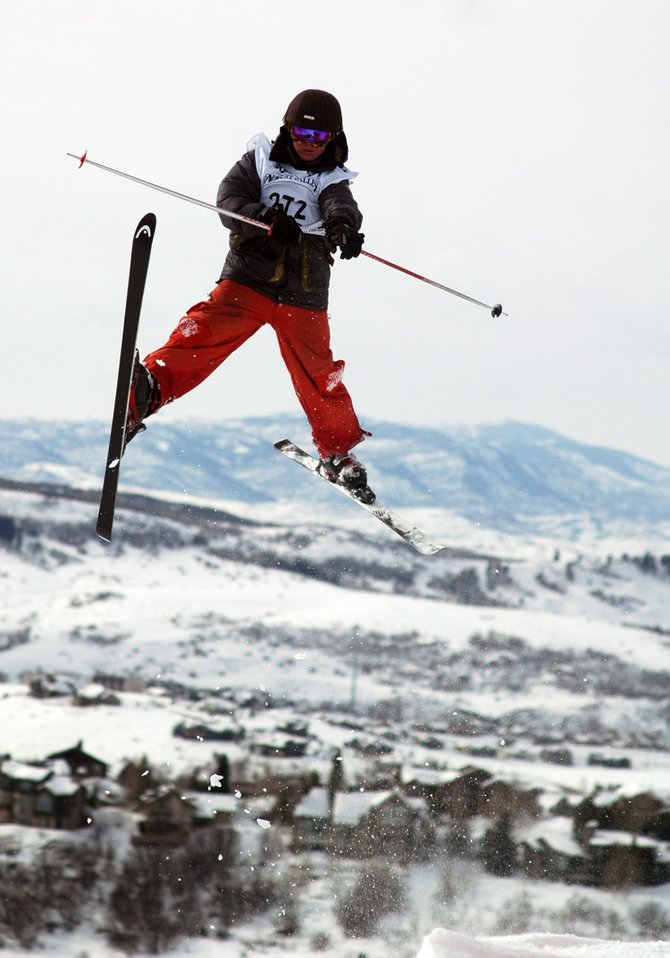 Steamboat Springs skier Tyler Saxe soars off a jump Saturday during the aerials competition at the Junior Olympics at Steamboat Ski Area. Saxe, one of three area competitors, finished 44th. The Junior Olympics resumes for its final day today with the dual moguls event.