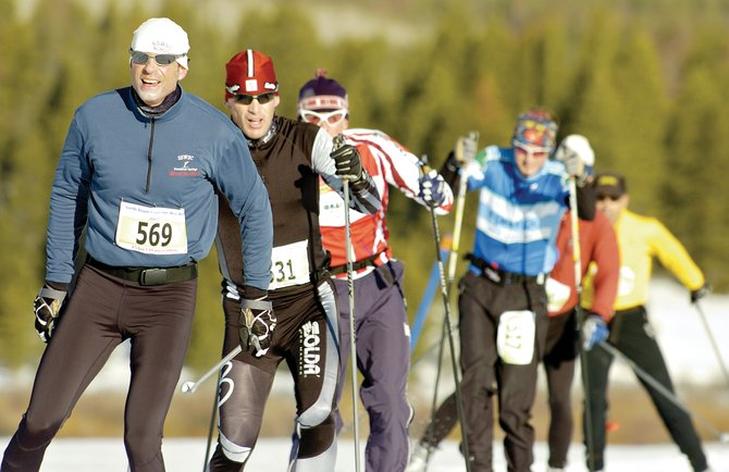 Brian Tate, left, leads a pack of skiers during the North Routt Coureur des Bois cross-country skiing race at Steamboat Lake on March 17, 2007.