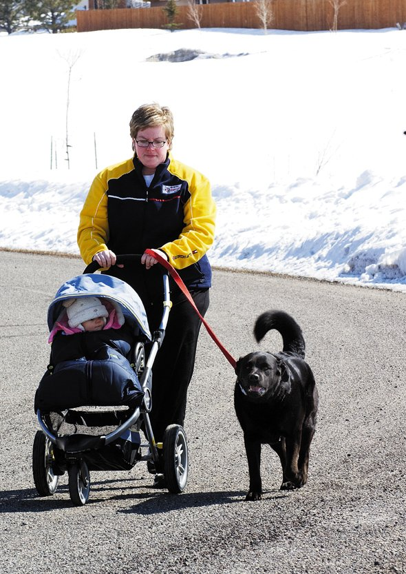 Steamboat Springs resident Shannon Ford and her daughter Ava used the extra hour of sunlight Monday to enjoy the spring-like weather. The family's pet, Elliemae, also seemed to enjoy the longer day and the warmer weather.