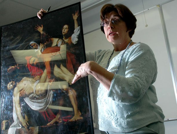 Mary Karen Solomon, a humanities and English instructor at Colorado Northwestern Community College, gives a presentation Monday on an Italian artist who students will study on an upcoming trip to Europe. The travelers embark Thursday for Italy and France and are scheduled to return March 24.