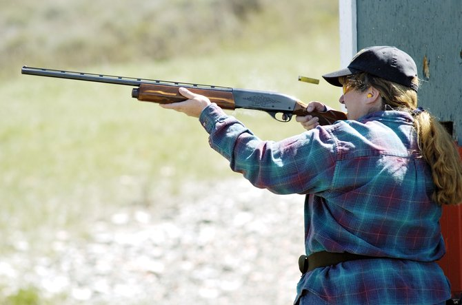 Deb Schaffer ejects a spent shell casing from her shotgun while taking aim at another skeet on the Routt County Rifle Club's range west of Steamboat Springs on April 28, 2007. Rifle Club filed a lawsuit against Steamboat 700 because of a disputed property line.