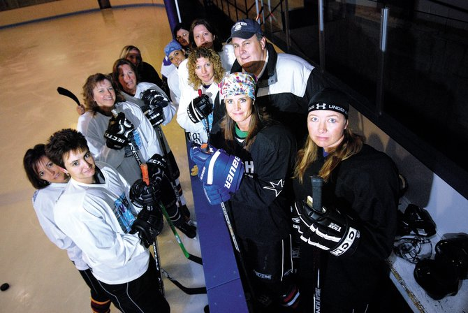The Craig Puck Ewes, clockwise from bottom left are, Jamie Eckroth, Lani Cleverly, Tammy Strahan, Charlene Abdella, Shannon Young, Becky Milot-Bradford, Stephanie Beckett, Annie Abdella, Gayle Criswell, coach Jerry Strahan, Terri Jourgensen and Wendy Buckley. Not pictured is Kandice Torno. The two-time defending champions of the Women's Association of Colorado Hockey - Mountain Division, will look to three-peat when the playoffs begin April 4.