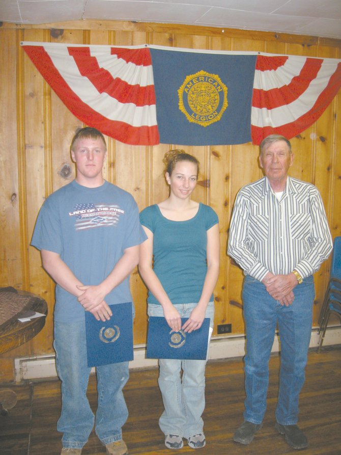 American Legion Post Commander Bob Hayes presents certificates to Garrett Murchison and Caitlin Mahanna.