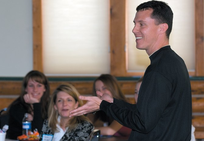Kevin Basik, a motivational speaker from Florida, humors a select group of students from Northwest Colorado who were attending the fifth annual Rout County Leadership Symposium on Monday.