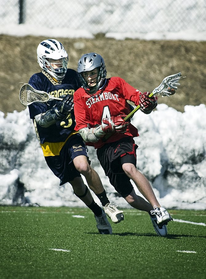 Steamboat's Ian Anderson, right, breaks past an Evergreen defender during Saturday's game between the Sailors and Evergreen High School. Steamboat defeated Evergreen, 10-8, for its first win of the season.