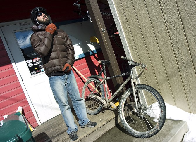 Big Agnes Head of Warranty Chris Tamucci suits up for his bicycle commute home from work at the BAP! location in downtown Steamboat Springs on Friday afternoon. Tamucci rides his bike to work year-round despite adverse weather conditions.