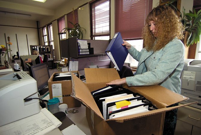 Tina Fry packs a box at the Routt County Clerk and Recorder's Office Monday afternoon. The office will be moving down the hall later this week as part of a renovation project at the Routt County Courthouse.