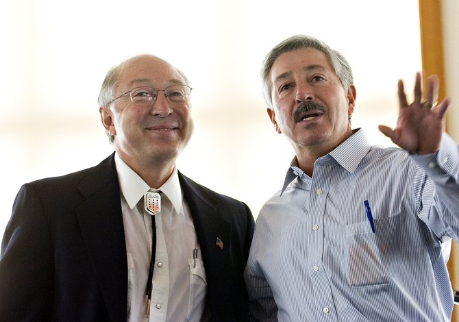 U.S. Senator Ken Salazar, left, and his brother, U.S. Representative John Salazar, speak to a group of local elected officials, community leaders and other members of the public in Olympian Hall at Howelsen Hill in Steamboat Springs on Tuesday morning.
