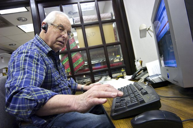 Ace Hardware employee Richard Dastyck works on a computer in his office at the store. Dastyck taught for almost 30 years and began working at Ace part-time after he retired.