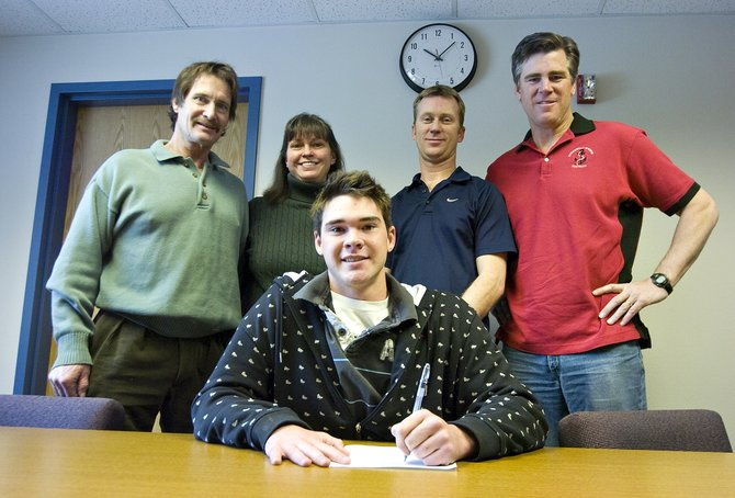 Mac Marsh, center, signed his letter of intent to play football for Western State College of Colorado at Steamboat Springs High School on Thursday morning. Marsh's parents, Steve and Jeannie Marsh, from left, and coaches Lonn Clementson and Aaron Finch were all present to support Marsh as he signed the letter.