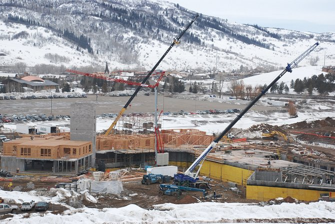 A trio of cranes is busy at the site of Trailhead Lodge in Wildhorse Meadows this week. Business professor Glenn Mueller says real estate markets in Colorado mountain towns are relatively immune to the current national economy downturn.