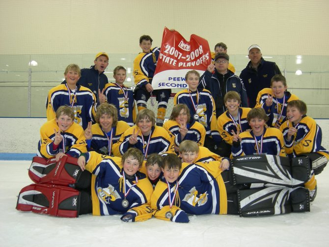 The Steamboat Springs Peewee A team holds up its second-place state tournament banner Sunday. The team beat a Denver team in the semifinals, 3-1, before falling to the Mountain State Renegades, 7-1, in the championship game. 