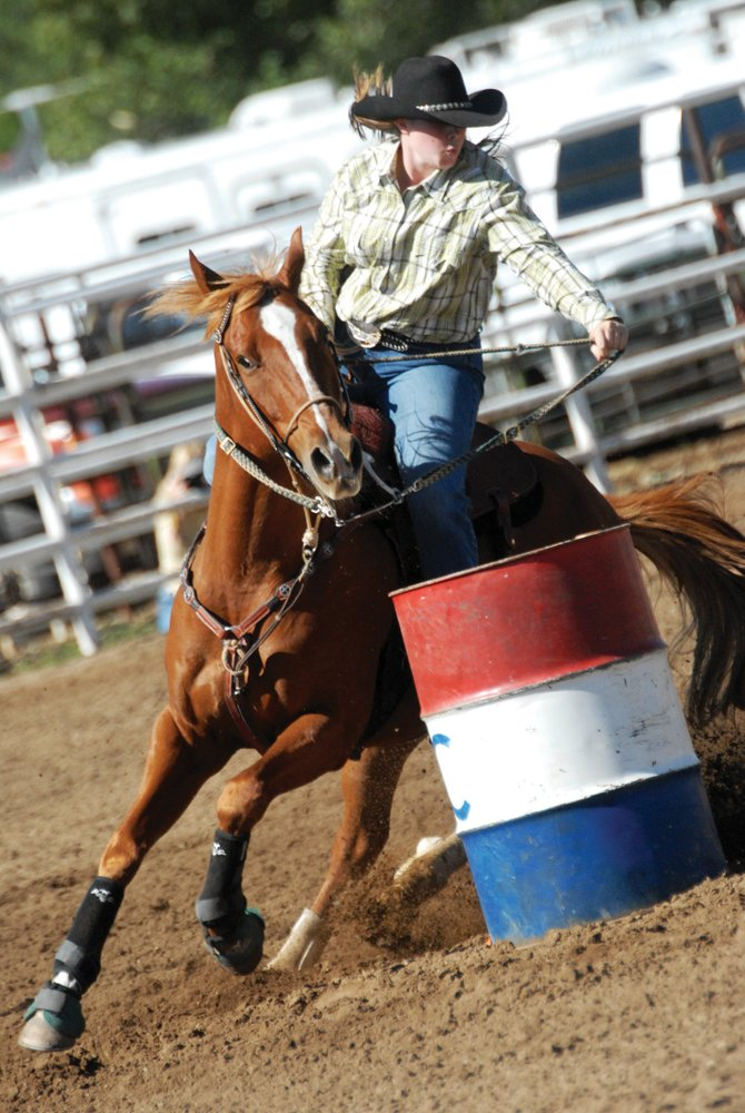 Stevie Brumback, a senior at Moffat County High, competes in the barrel race during the High School Rodeo at Moffat County Fairgrounds in September. Brumback is riding Drac.